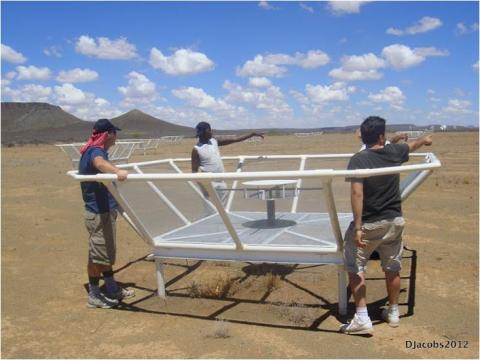 Members of the Cambridge and SA teams reconfiguring the array.